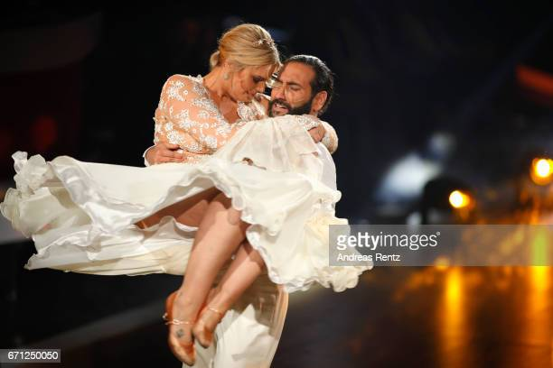 Angelina Kirsch and Massimo Sinato perform on stage during the 5th show of the tenth season of the television competition 'Let's Dance' on April 21...