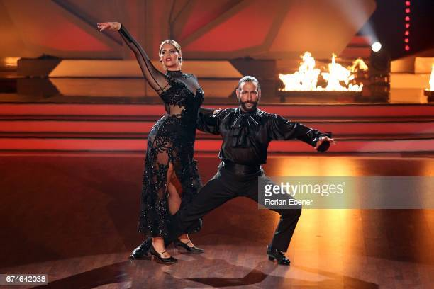 Angelina Kirsch and Massimo Sinato perform on stage during the 6th show of the tenth season of the television competition 'Let's Dance' on April 28...
