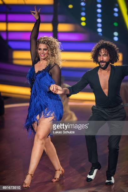 Angelina Kirsch and Massimo Sinato perform on stage during the semi final of the tenth season of the television competition 'Let's Dance' on June 2...