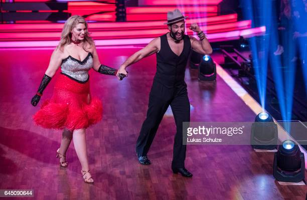 Angelina Kirsch and Massimo Sinato perform on stage during the preshow 'Wer tanzt mit wem Die grosse Kennenlernshow' for the television competition...