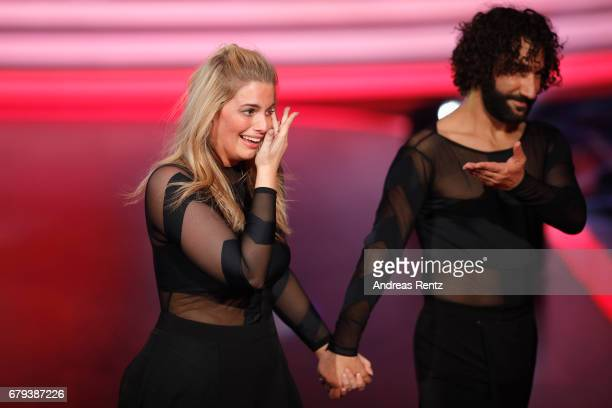 Angelina Kirsch and Massimo Sinato react on stage during the 7th show of the tenth season of the television competition 'Let's Dance' on May 5 2017...