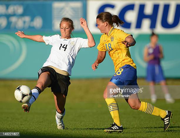 Angelina Luebcke of Germany is challenged by Emila Appelqvist of Sweden during the U23's womens international friendly mtach between Germany and...
