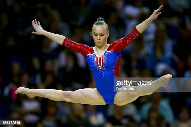 Angelina Melnikova of Russia competes on the beam during the women's competition for the iPro Sport World Cup of Gymnastics at The O2 Arena on April...