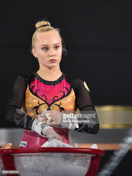 Angelina Melnikova of Russia looks on as she prepares to compete on the uneven bars during the women's individual allaround final of the Artistic...