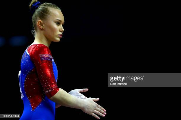 Angelina Melnikova of Russia prepares to compete on the beam during the women's competition for the iPro Sport World Cup of Gymnastics at The O2...