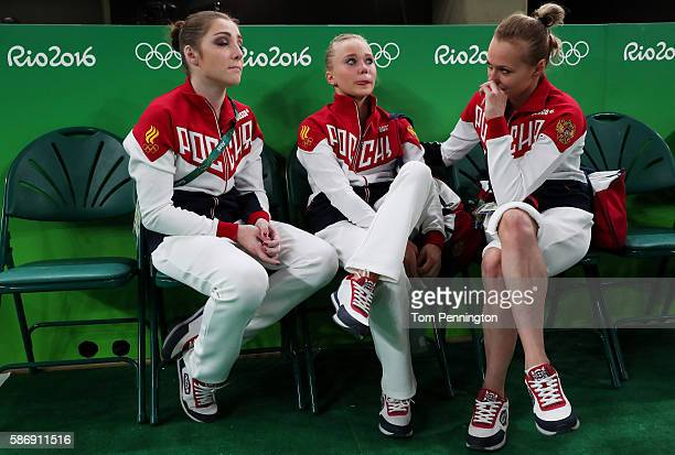 Angelina Melnikova of Russia shows her emotion while Aliya Mustafina and Daria Spiridonova console after Women's qualification for Artistic...