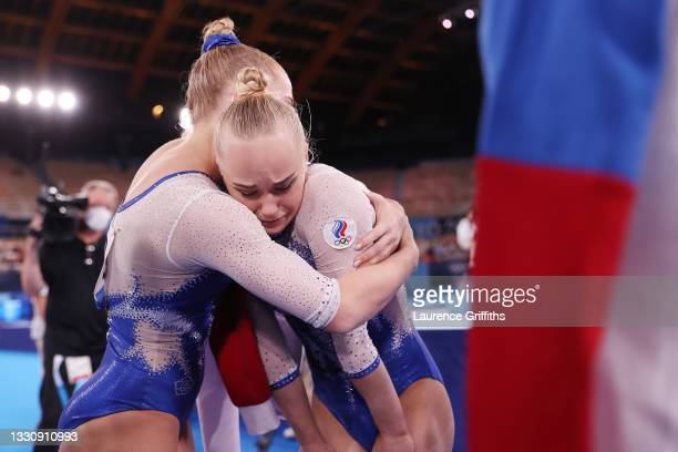 Angelina Melnikova of Team ROC reacts is embraced by Liliia Akhaimova of Team ROC after competing in floor exercise during the Women's Team Final on...