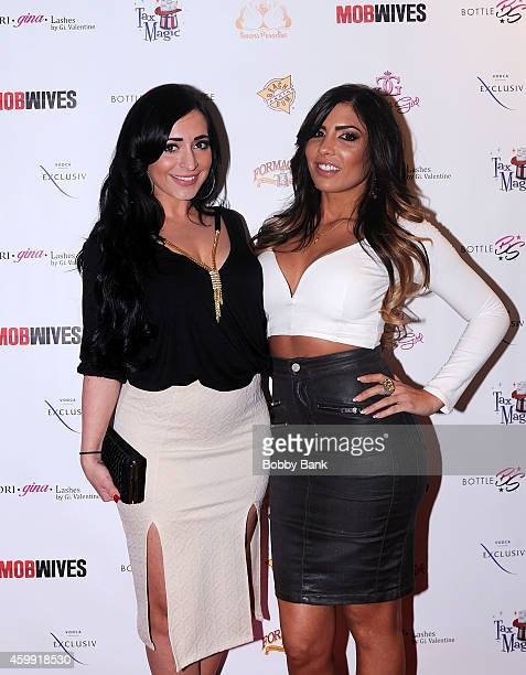 Angelina Pivarnick and Natalie Guercio of Mob Wives attend Mob Wives Season Five Viewing Party at Drunken Monkey on December 3 2014 in New York City