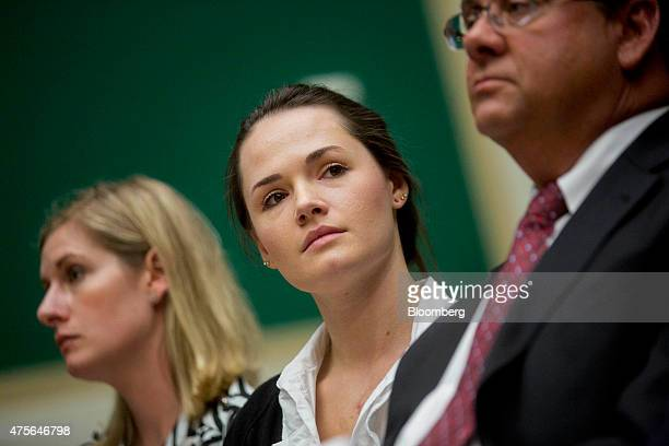 Angelina Sujata a victim of a faulty Takata Corp airbag center listens during a House Energy and Commerce Committee Subcommittee hearing on an update...