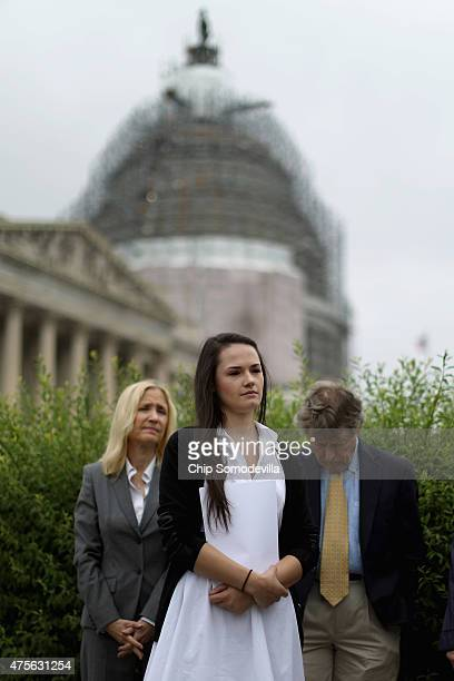 Angelina Sujata who was injured three years ago by a defective Takata airbag joins members of Congress for a news conference outside the US Capitol...