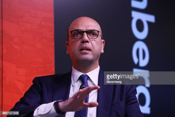 Angelino Alfano Italy's foreign minister gestures while speaking during a panel discussion on the topic of Italy Now and Next in London UK on...