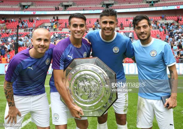Angelino, Eric Garcia, Rodri, and David Silva of Manchester City celebrate with the FA Community Shield following their team's victory in the FA...