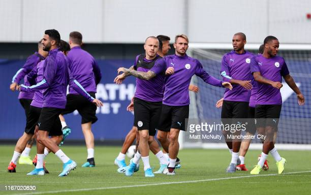 Angelino of Manchester City warms up with teammates during the training session at Manchester City Football Academy on August 09 2019 in Manchester...