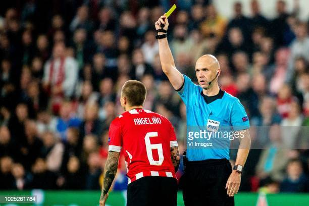 Angelino of PSV referee Anthony Taylor during the UEFA Champions League play offs round second leg match between PSV Eindhoven and BATE Borisov at...