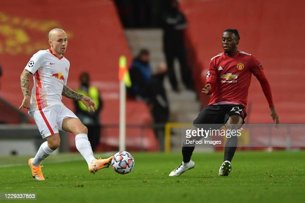 Angelino of RB Leipzig and Aaron WanBissaka of Manchester United battle for the ball during the UEFA Champions League Group H stage match between...