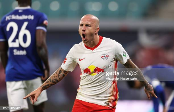 Angelino of RB Leipzig celebrates after scoring his team's second goal during the Bundesliga match between RB Leipzig and FC Schalke 04 at Red Bull...