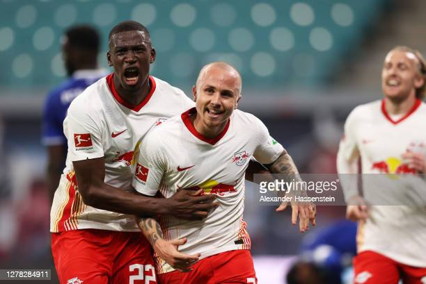 Angelino of RB Leipzig celebrates with teammate Nordi Mukiele after scoring his team's second goal during the Bundesliga match between RB Leipzig and...