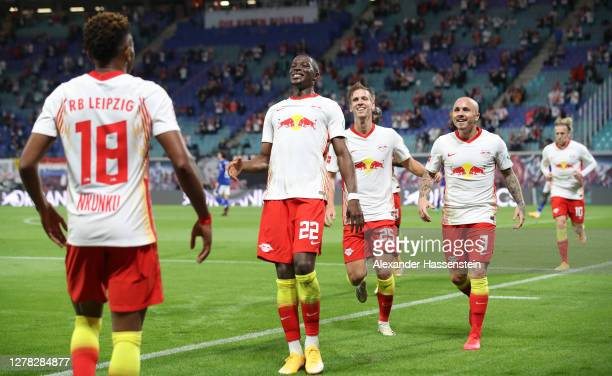 Angelino of RB Leipzig celebrates with teammates after scoring his team's second goal during the Bundesliga match between RB Leipzig and FC Schalke...