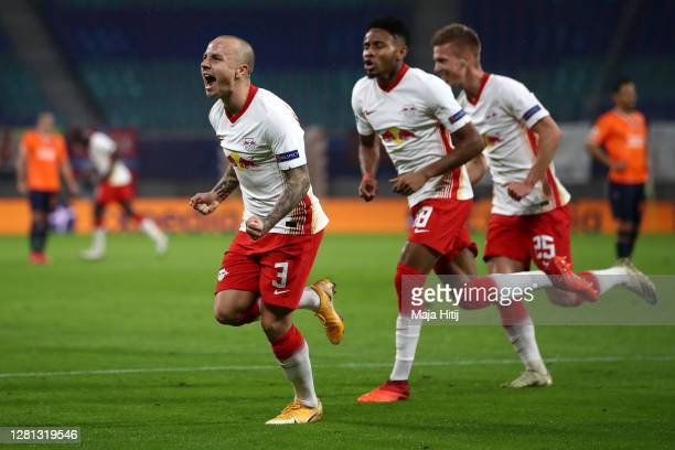 Angelino of RB Leipzig celebrates with teammates after scoring his sides first goal during the UEFA Champions League Group H stage match between RB...