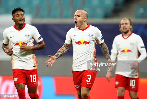 Angelino of RB Leipzig celebrates with teammates after scoring his sides second goal during the UEFA Champions League Group H stage match between RB...