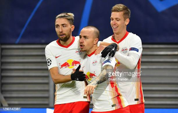 Angelino of RB Leipzig celebrates with teammates after scoring their team's first goal during the UEFA Champions League Group H stage match between...