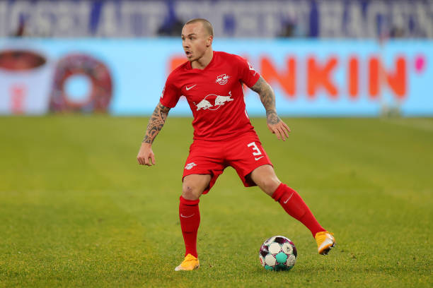 Angelino of RB Leipzig controls the ball during the Bundesliga match between FC Schalke 04 and RB Leipzig at Veltins-Arena on February 06, 2021 in...