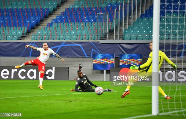 Angelino of RB Leipzig scores their team's first goal past David De Gea of Manchester United during the UEFA Champions League Group H stage match...