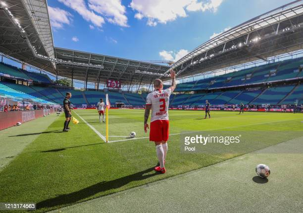 Angelino of RB Leipzig takes a corner kick during the Bundesliga match between RB Leipzig and SportClub Freiburg at Red Bull Arena on May 16 2020 in...