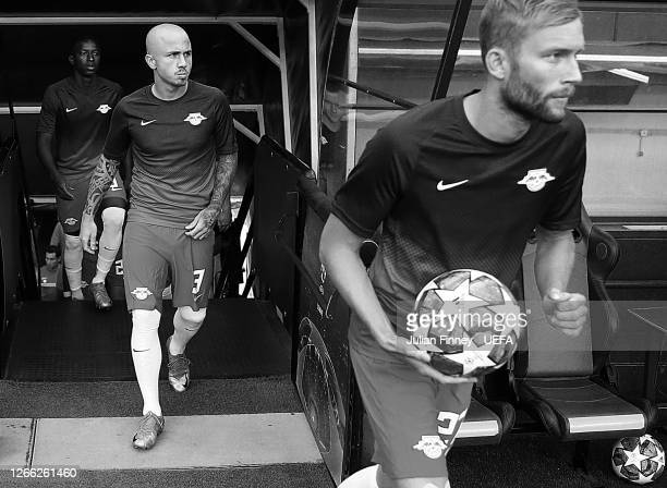 Angelino of RB Leipzig walks out for the warm up prior to the UEFA Champions League Quarter Final match between RB Leipzig and Club Atletico de...