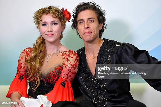 Angelique Abachkina and Louis Thauron of France pose for a photographs at the kiss and cry after the junior ice dance free dance free program during...