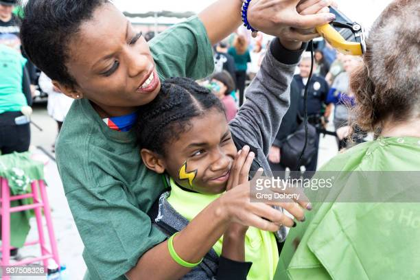 Angelique Bates and Christopher Bates shaves heads at the St Baldrick's Foundation Celebrity Event on March 24 2018 in North Hollywood California
