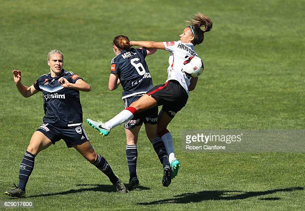 Angelique Hristodoulou of the Wanderers challenges Annabel Martin of the Vcitory during the round six WLeague match between Melbourne Victory and...