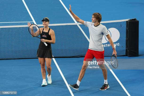 Angelique Kerber and Alexander Zverev of Germany celebrate winning their mixed doubles match against Garbine Muguruza and David Ferrer of Spain...