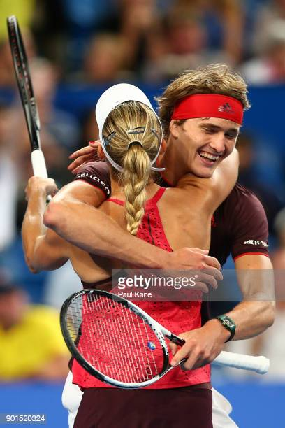 Angelique Kerber and Alexander Zverev of Germany celebrate winning the mixed doubles match against Thanasi Kokkinakis and Daria Gavrilova of...