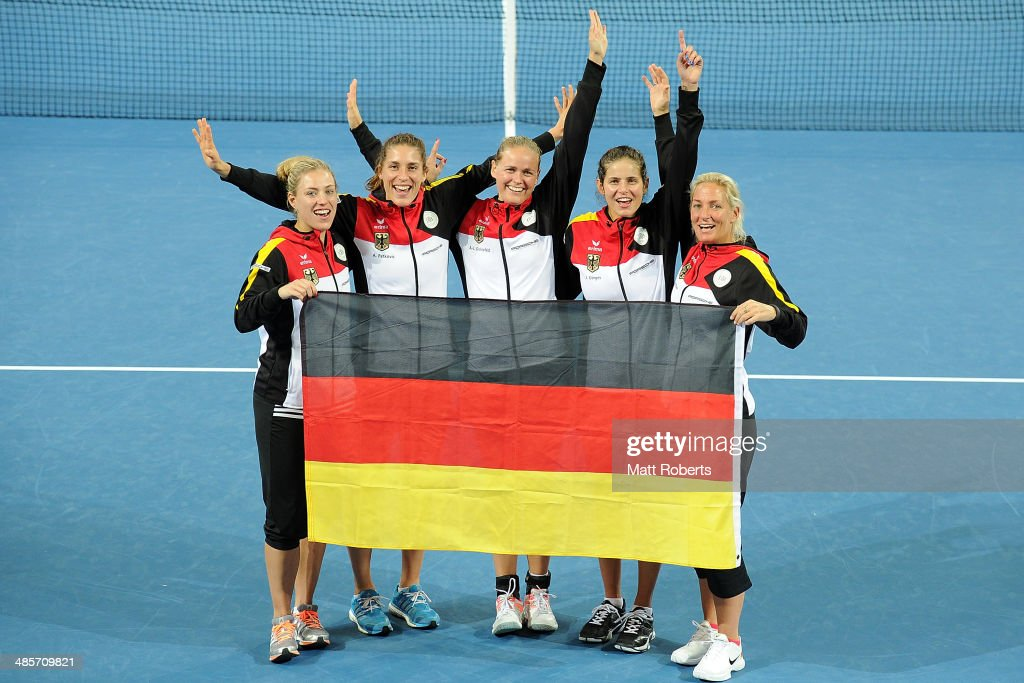 Angelique Kerber, Andrea Petkovic, Anna-Lena Groenefeld, Julia Goerges and Barbara Rittner pose for a photograph after during the Fed Cup Semi Final tie between Australia and Germany at Pat Rafter Arena on April 20, 2014 in Brisbane, Australia.