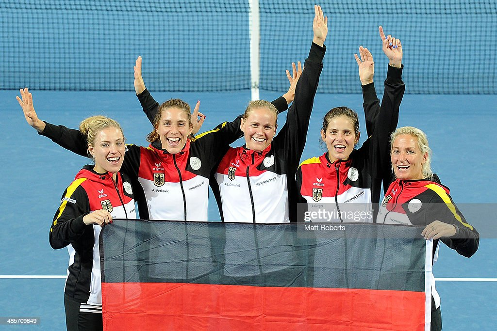 Angelique Kerber, Andrea Petkovic, Anna-Lena Groenefeld, Julia Goerges and Barbara Rittner of Germany pose for a photograph after during the Fed Cup Semi Final tie between Australia and Germany at Pat Rafter Arena on April 20, 2014 in Brisbane, Australia.