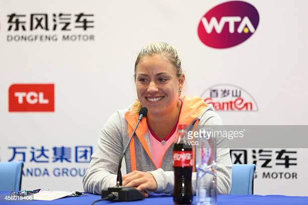 Angelique Kerber attends a press conference during day four of the 2014 Dongfeng Motor Wuhan Open at Optics Valley International Tennis Center on...