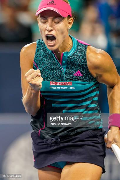 Angelique Kerber celebrates after winning her game against Anastasia Pavlyuchenkova during the Western Southern Open at the Lindner Family Tennis...