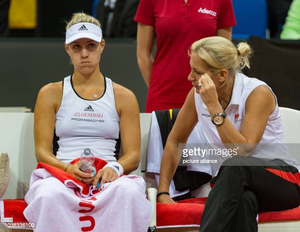 Angelique Kerber form Germany speaks to team head Barbara Rittner during her match against Svitolina from Ukraine at the Federation Cup world group...