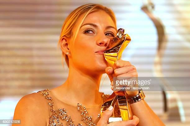 Angelique Kerber kisses her Sportler des Jahres 2016 award during the Sportler des Jahres 2016 gala at Kurhaus BadenBaden on December 18 2016 in...