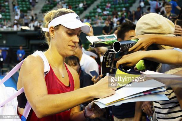 Angelique Kerber of German celebrate sins a fun Naomi Osaka of Japan during women's singles match day one of the Toray Pan Pacific Open Tennis At...