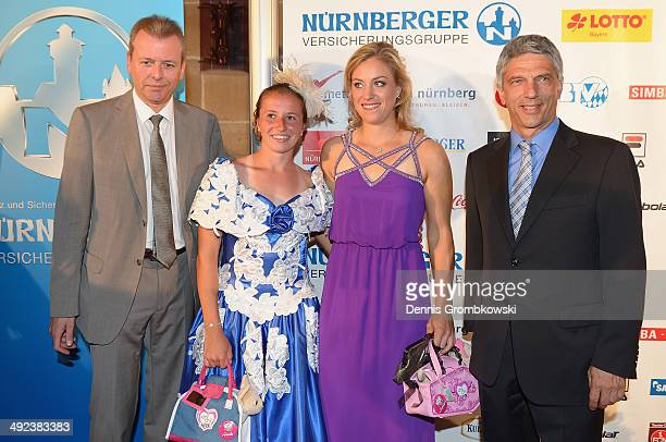 Angelique Kerber of Germany and Annika Beck arrive for the Player's Party during Day 3 of the Nuernberger Versicherungscup on May 19 2014 in...