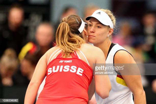 Angelique Kerber of Germany and Belinda Bencic of Switzerland kiss goodbye after the Fed Cup tennis quarterfinal tennis match between Germany and...