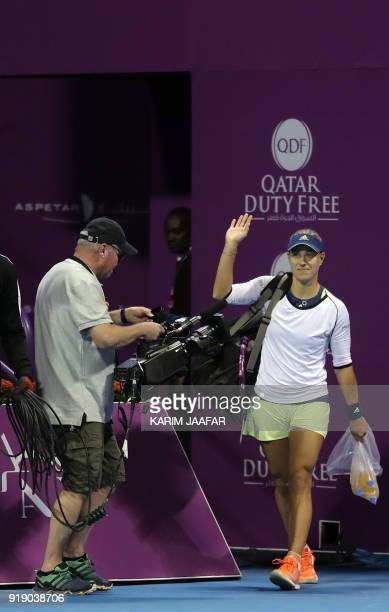 Angelique Kerber of Germany arrives on the court ahead of her match with Caroline Wozniacki of Denmark in their singles match during the quarterfinal...