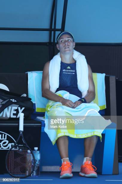 Angelique Kerber of Germany attempts to cool down between games in her second round match against Donna Vekic of Croatia on day four of the 2018...