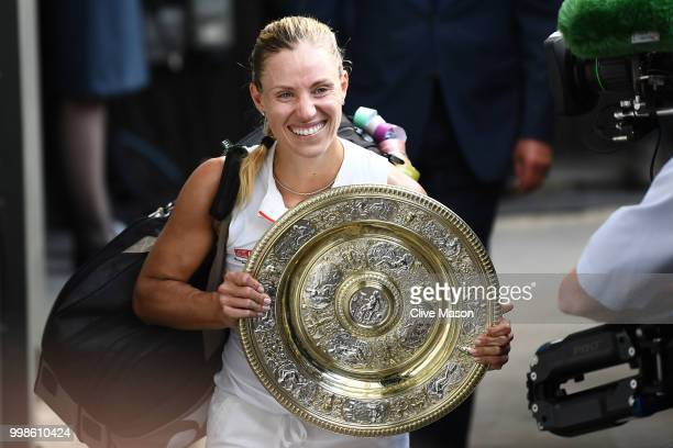 Angelique Kerber of Germany carries the Venus Rosewater Dish after defeating Serena Williams of The United States in the Ladies' Singles final on day...