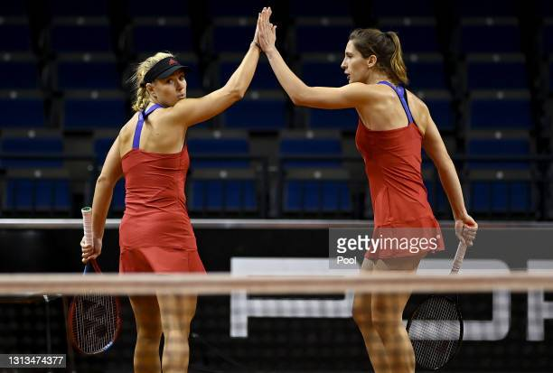 Angelique Kerber of Germany celebrate with Andrea Petkovic of Germany during their Womens Doubles match against Lyudmyla Kichenok of Ukraine and...
