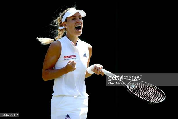 Angelique Kerber of Germany celebrates a point against Vera Zvonareva of Russia during their Ladies' Singles first round match on day two of the...