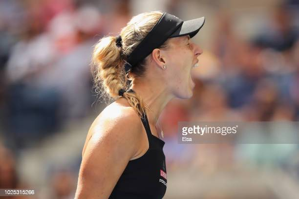 Angelique Kerber of Germany celebrates a point during her women's singles second round match against Johanna Larsson of Sweden on Day Four of the...