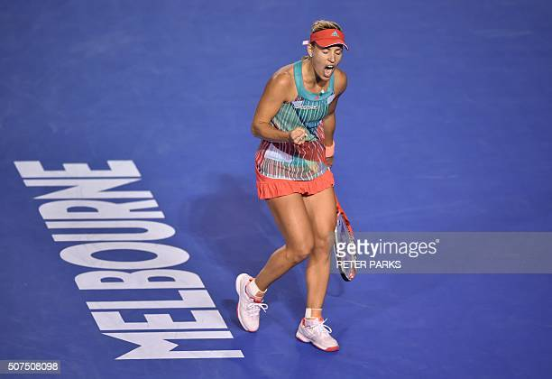 Angelique Kerber of Germany celebrates after breaking the serve against Serena Williams of the US in the third set of their women's singles final...